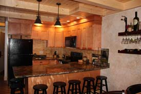 The kitchen area of a 3-bedroom townhome in Arcadia Village at Greek Peak Mountain Resort.