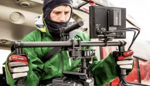 follow the forecast - image from movie featuring cameraman with equipment recording movie