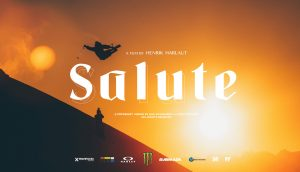 Salute - Movie Poster for the iF3 Ski and Snowboard Film Festival - Photo of sunset with snowboarder in mid-air