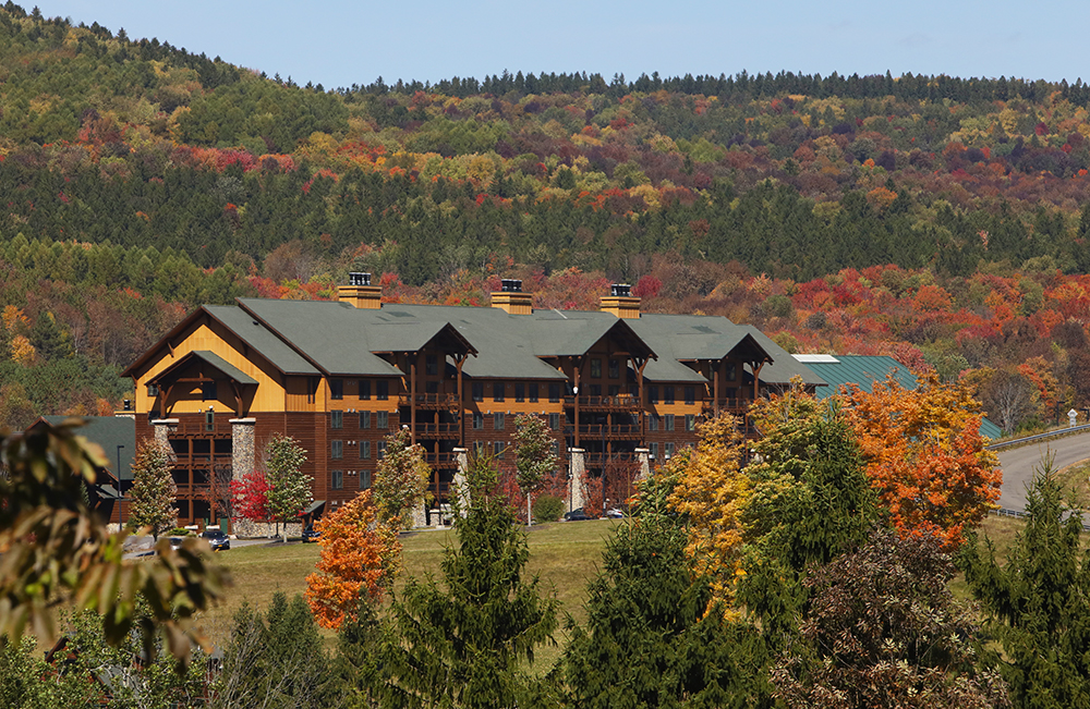 Greek Peak Mountain Resort - image of resort with fall foliage in the background