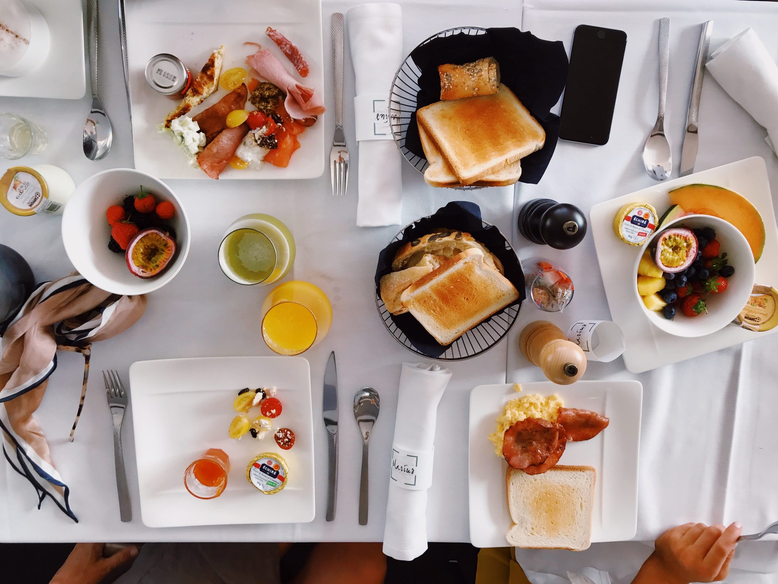 a table with lots of different breakfast/brunch foods on it for our Sunday Brunches.