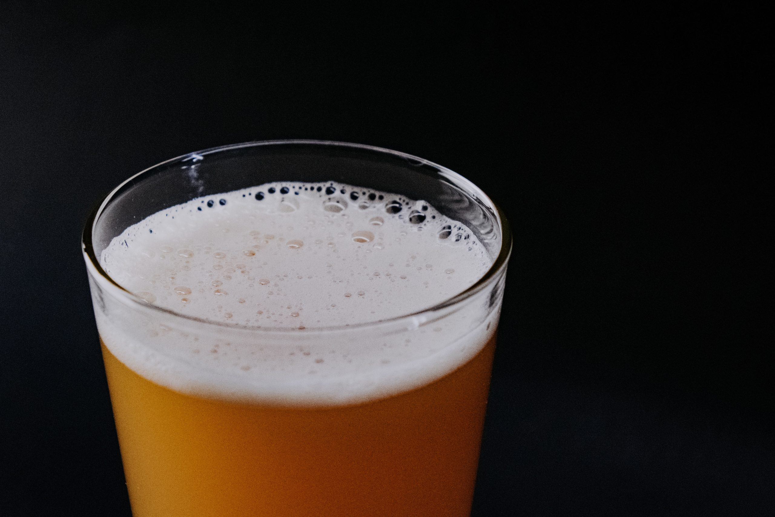 pint of beer with foam on top